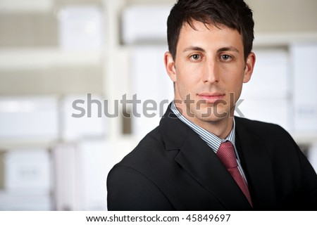 An attractive businessman standing in his office