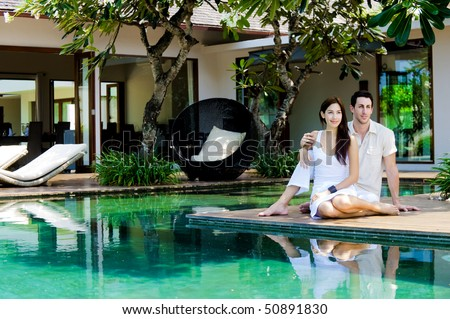 An attractive caucasian couple relaxing and lounging outdoors - stock photo