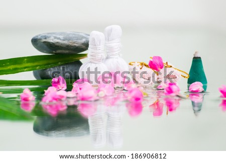 An attractive caucasian model lying down on a massage bed at a spa - stock photo