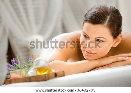 An attractive caucasian woman lying down in a spa - stock photo