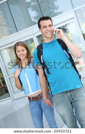 An attractive couple at school (Focus on Woman) - stock photo