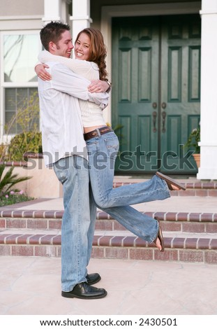 An attractive couple celebrating their new home - stock photo