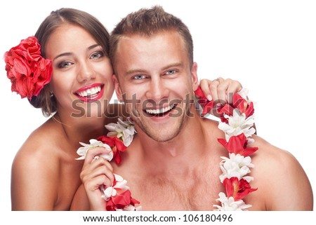 An attractive couple enjoying their honeymoon on a tropical vacation. Isolated on white background - stock photo