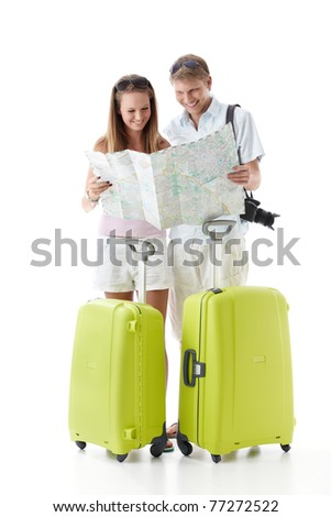 An attractive couple with suitcases see map on a white background - stock photo