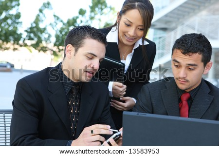 An attractive, diverse business team at office building - stock photo