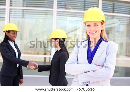 An attractive diverse man and woman architect team on construction site - stock photo