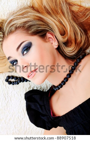 An attractive fashionable woman posing in the interior. - stock photo