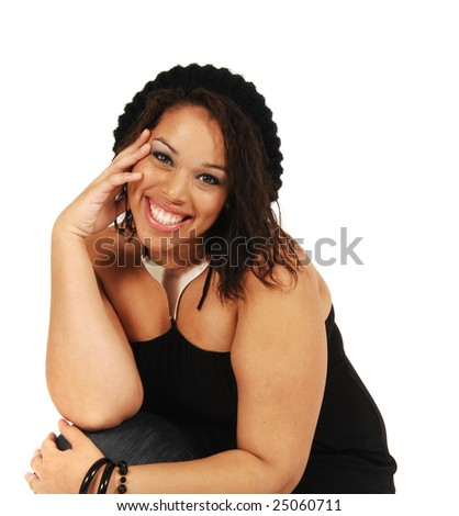 An attractive full figured model in a stylish black outfit. - stock photo