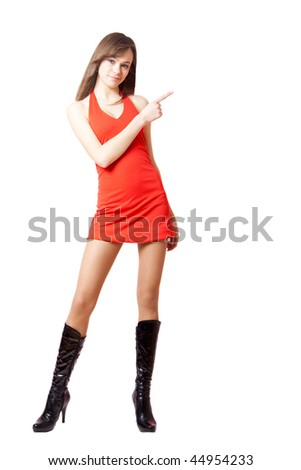 an attractive girl pointing at something - stock photo