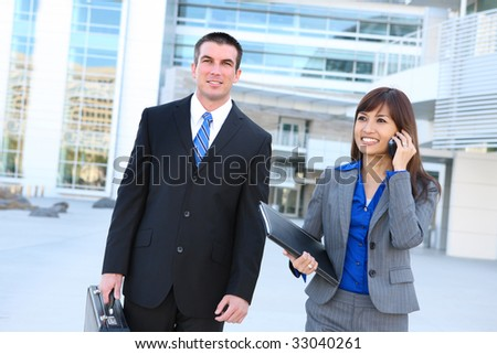 An attractive man and woman business team at the office