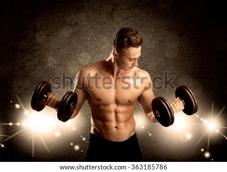 An attractive muscular guy working out with weights and showing naked upper body with illustrated lights and bokeh concept - stock photo