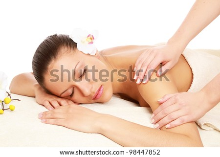 An attractive woman getting spa treatment, side-view - stock photo