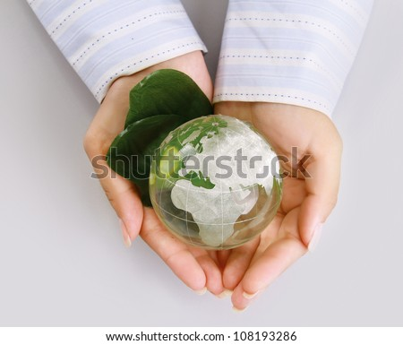 An attractive woman holding a glass globe