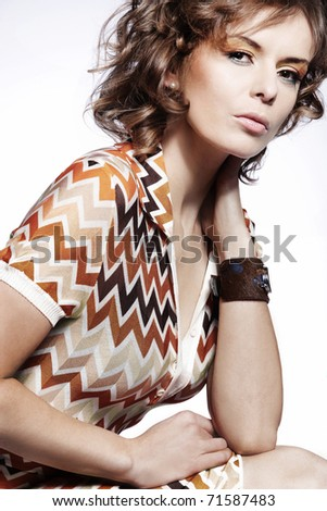 An attractive  woman posing in a summer dress. - stock photo