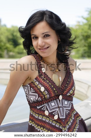 An attractive woman smiles at camera.