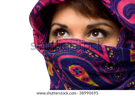 An attractive woman wearing a traditional head covering. - stock photo
