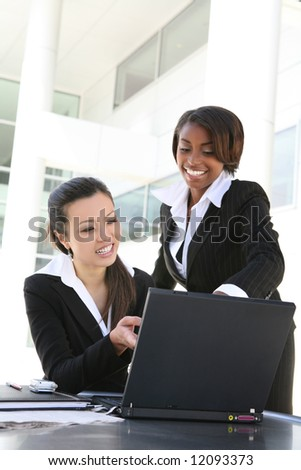 An attractive women business team (Focus on Asian Woman) - stock photo