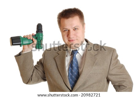 An attractive worker with a screwdriver. - stock photo