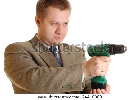 An attractive worker with a screwdriver like gun. - stock photo