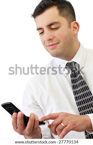 An attractive young businessman dialing numbers on his cell phone over white - stock photo