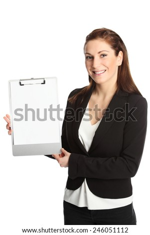 An attractive young businesswoman in her 20s standing wearing a white shirt and suit. White background. - stock photo