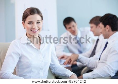 An attractive young girl in the office - stock photo