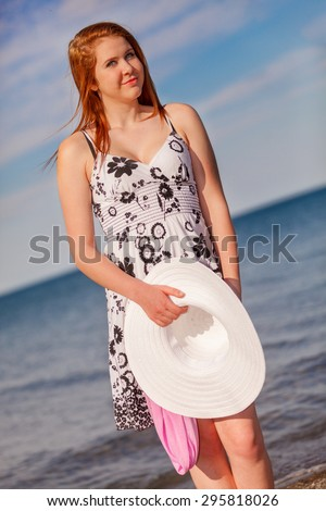 An attractive young woman at the beach - stock photo