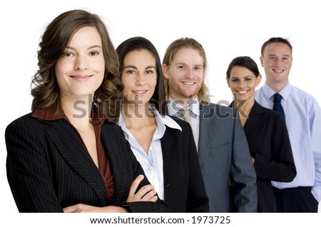 An attractive young woman heads up a young business team of professionals (shallow depth of field)