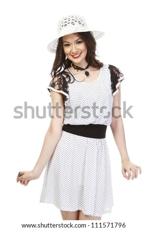 An attractive young woman in a fashionable summer dress (isolated on white background)