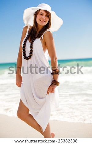 An attractive young woman on the beach - stock photo