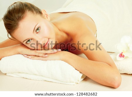 An attractive young woman receiving spa treatment - stock photo