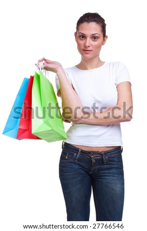An attractive young woman waits arms folded with colourful shopping bags, isolated on a white background. - stock photo