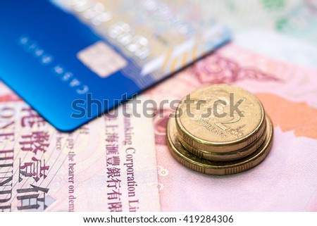 An Australia 2 dollars coins on notes and credit card.  - stock photo