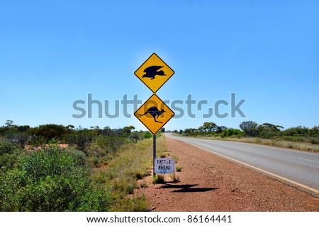 An Australian kangaroo & Eagle  warning sign on the side of a road in Western Australia - stock photo