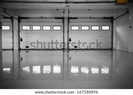 an auto motor speedway garage, interior, windows - stock photo