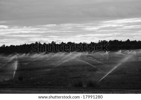 an automated irrigation system in rural Quebec town - stock photo