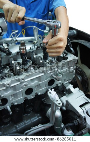 an automotive mechanic tightening using torque wrench - stock photo