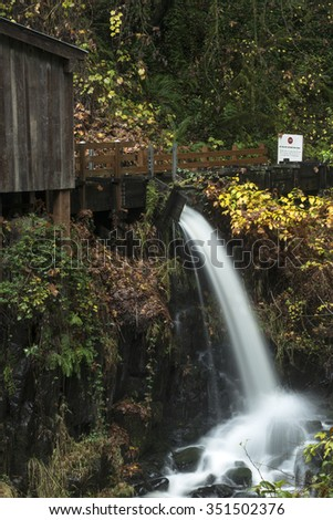 An autumn view of the Cedar Creek Grist Mill outside of Woodland, Washington. - stock photo
