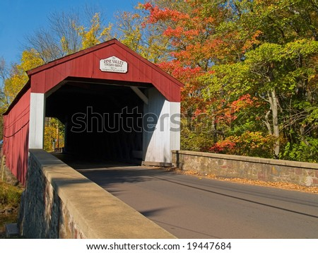 An Autumn view of the historic Pine Valley Covered Bridge located in Bucks County, Pennsylvania. - stock photo