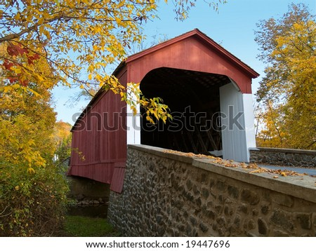 An Autumn view of the historic Van Sant Coverd Bridge located in Bucks County, Pennsylvania. - stock photo
