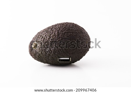 an avocado with a USB-port, the evolution of the fruit - stock photo