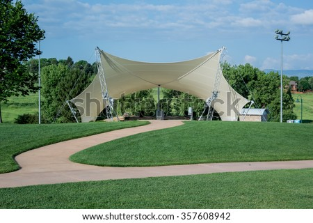 An awning covers an amphitheater in a public park