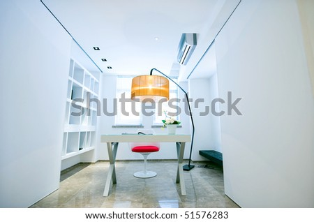 An beautiful office interior inside an upscale home. - stock photo