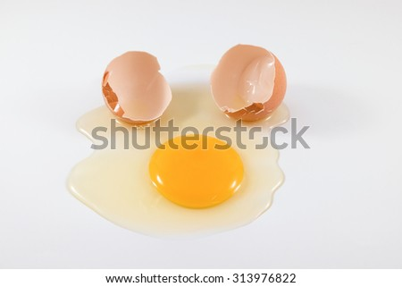An broken egg on the white table. - stock photo