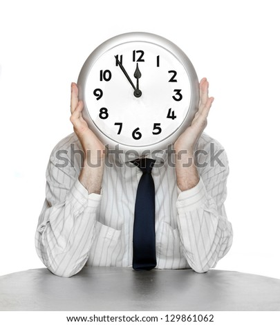 An businessman with a clock face. Time is money concept. - stock photo