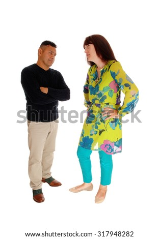 An Caucasian woman looking very frustrated at her Hispanic husband, standing in front of him, isolated for white background.