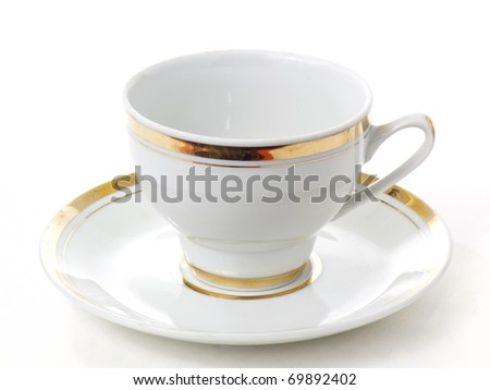 An classic empty porcelain cup for coffee or tea isolated on white background - stock photo