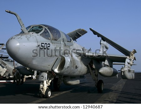 An EA-6B Prowler Electronic Attack aircraft taxies on an aircraft carrier - stock photo