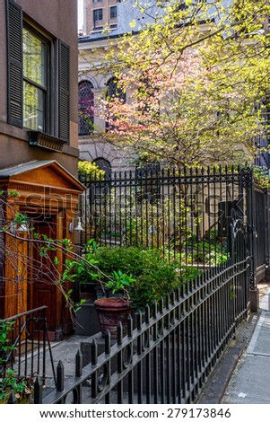 An East side sunny apartment courtyard in New York City. - stock photo