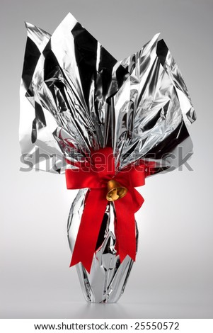 An Easter egg with red ribbon and bell - stock photo